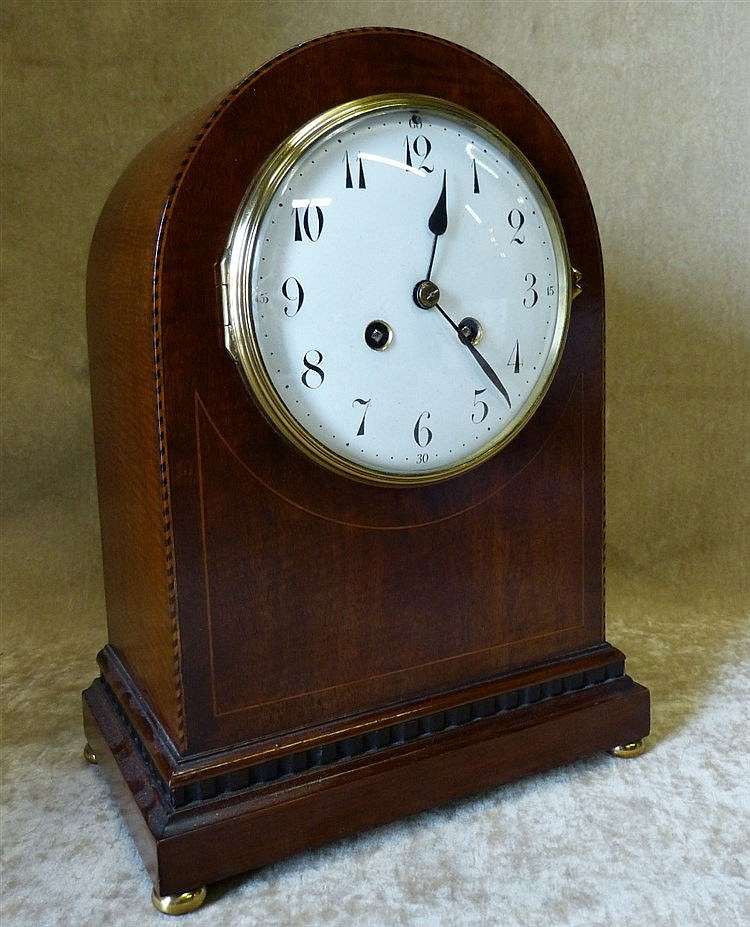 An Edwardian Mahogany Arched Top 8 Day Striking Mantle Clock havi