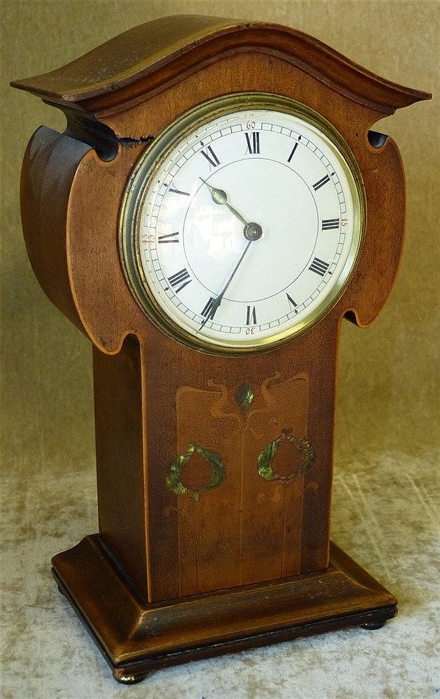 An Art Nouveau Mahogany Inlaid Timepiece with white enamel dial w