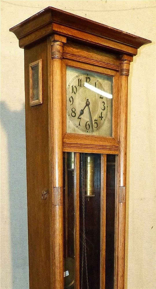 A Light Oak Arts and Crafts Style Longcase Clock having silvered