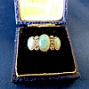 A Gold 3 Stone Opal Ladies Ring interspersed by 2 rows of 3 diamo