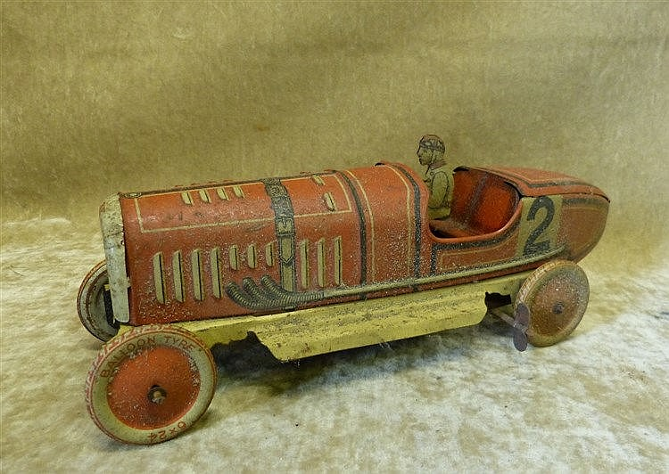 A Child's Clockwork German Tin Red Racing Car, 26.5cm long