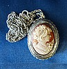 A Silver Oval Cameo Locket depicting figurehead of a lady with ma