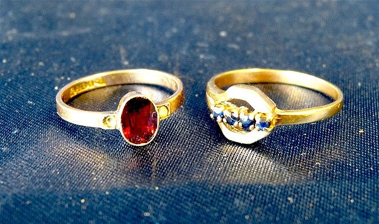 A Gold Ladies Ring set with 4 small blue stones, also another lad