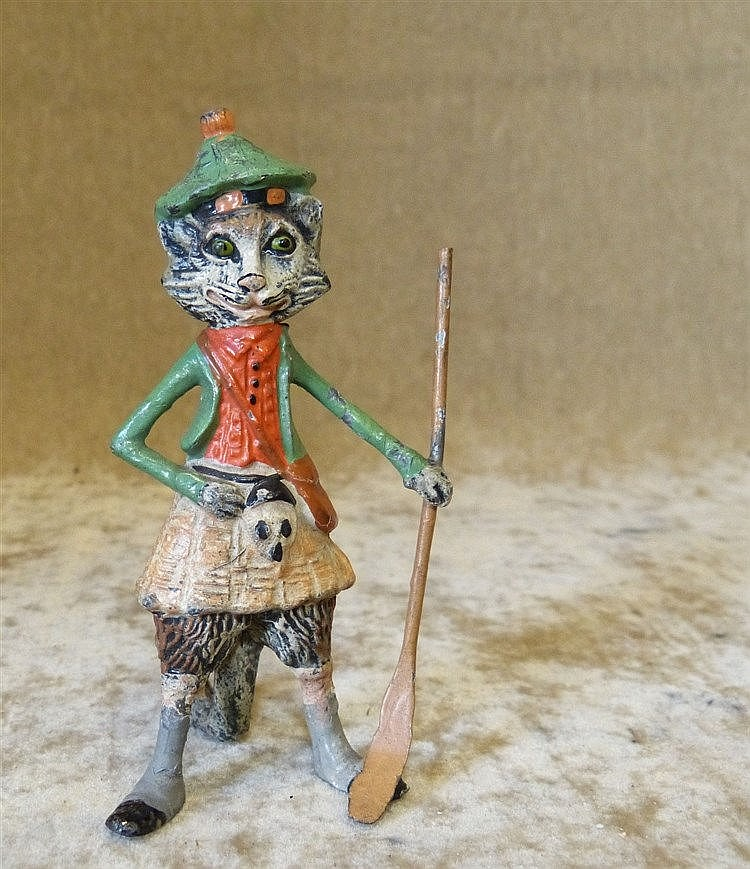 A Cold Painted Metal Figure of a standing cat in Scottish outfit