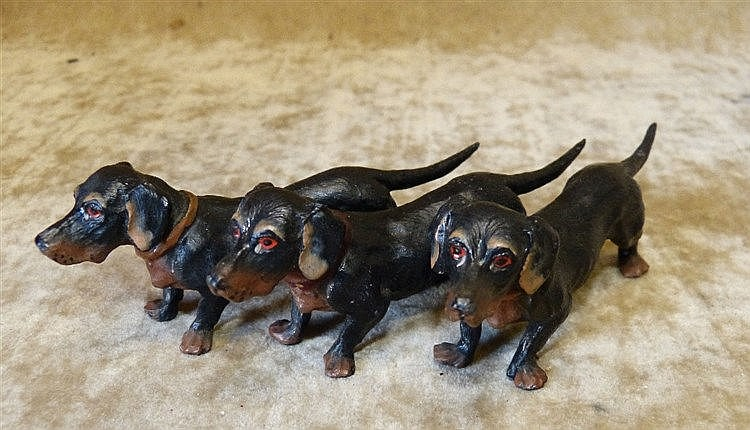 A Cold Painted Metal Group of 3 Dogs