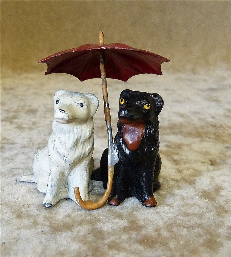 A Painted Metal Group of 2 Seated Dogs under an umbrella, 6cm hig