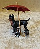 A Painted Metal Group of 3 Dogs under umbrella (smallest dog fron