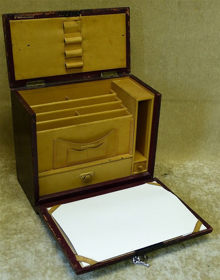 A Wooden and Red Leather Rectangular Travelling Writing Box havin
