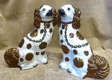 A Pair 19th Century Staffordshire Figures of seated Spaniels, on white and