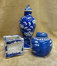 An Oriental Round Thin Neck Lidded Vase on blue and white ground with bloss