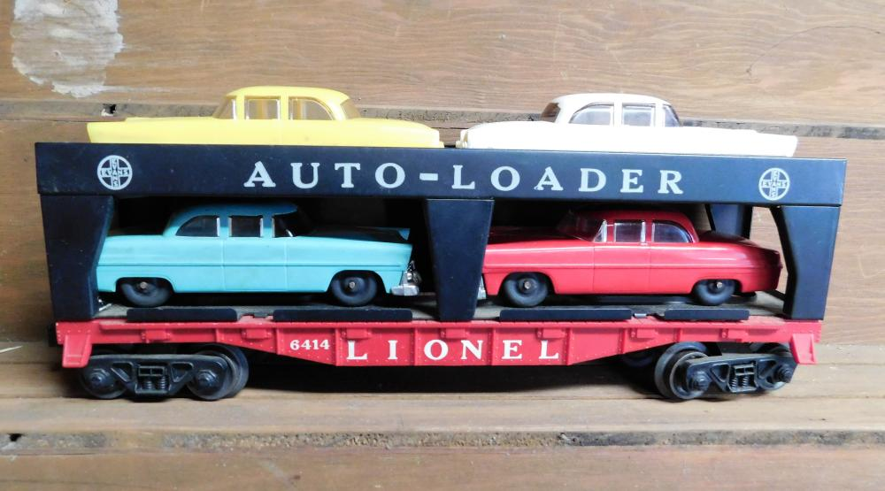 Lionel 6414 Auto Loader with 4 lionel cars.