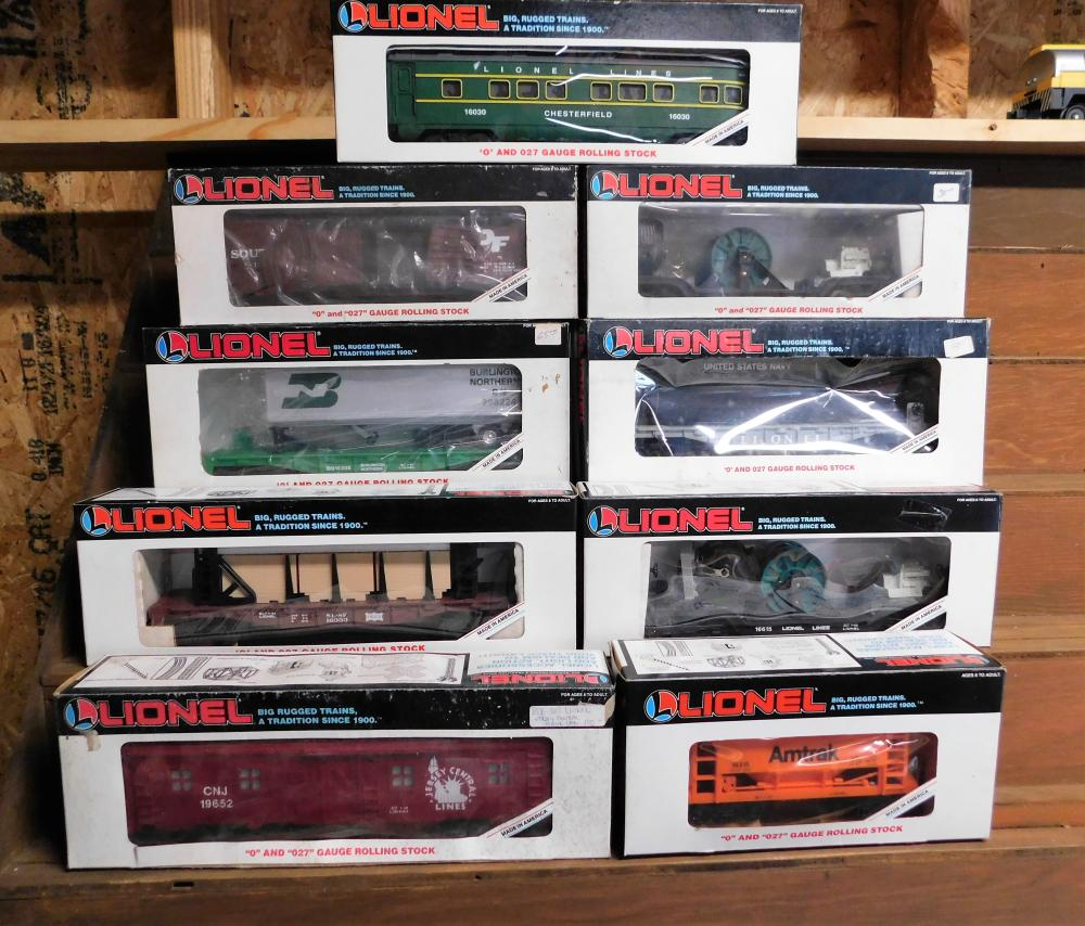 Lot of 9 Lionel 0 Gauge cars--Southern double door box, Burlington Northern flat car, Chesterfield observation car, US Navy, Lines extensions search light car (2), Jersey Central bunk car, Frisco Bulk head, and amtrak