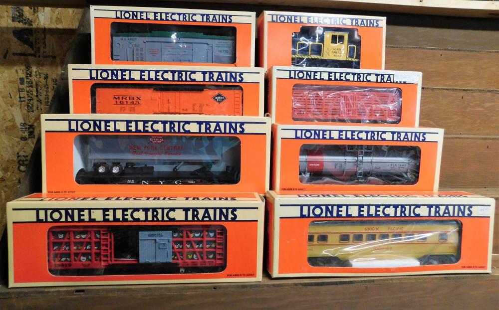 Lot 47: Lof of 8 Lionel cars--Poultry car, NYC flat car, Reeding reefer, Operating missile car, alaska railroad, animated circus clown car, santa fe single dome tanker, union pacific pullman car