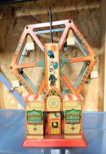 Lot 114: Tin litho wind up ferris wheel toy