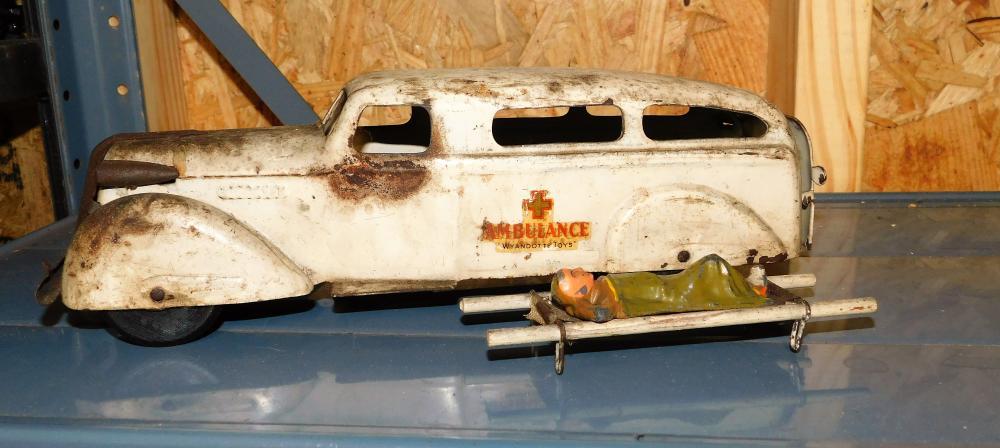 Lot 120: Wyandotte ambulance with stretcher and metal man--All Original