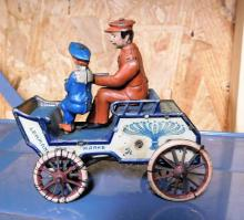 Lot 121: Lehamm's French wind up car w/ 2 men--Missing Arm