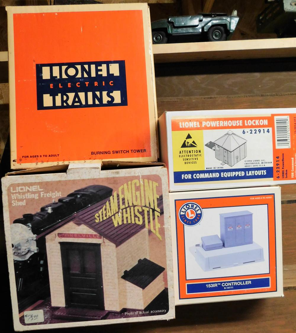 Lionel G-12768 Burning Switch Tower in box, Lionel whistling freight shed in box, Lionel powerhouse lock on in box, and Lionel 1531R controller in box