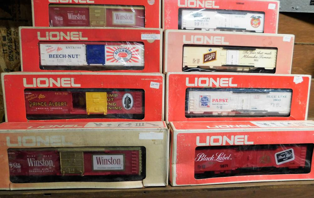 Lot 144: Lot of 8-Lionel beer cars (4) and tobacco railroad cars (4)