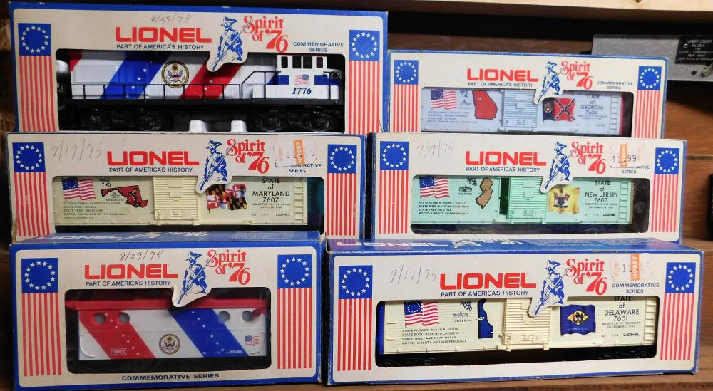 Lot 145: Lionel Spirit of '76 locomotive u36B diesel Maryland, Deleware, New Jersey, and Georgia cars and caboose