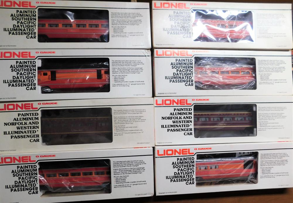 Lot of 8 Lionel painted Aluminum Illuminated passenger cars. N&W, Southern Pacific, Alum. Dining car, observation car, passenger car.