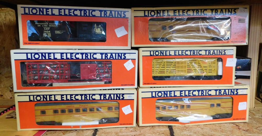 Lot 168: 6 Lionel cars-- 6-19801 Poultry dispatch, 6-7404 Jersey Central, 6-16072 Union Pacific Vista Dome, 6-16662 Bugs Bunny, 6-16068 Union Pacific baggage, 6-16069 New Haven