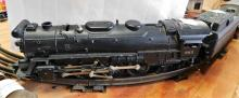 Lot 177: Lionel engine 665 with coal tender, lionel 2422 chatham car, 2421 maplewood car.