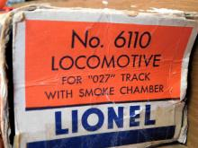 Lot 176: Lionel trains 6002, 6001T, 6007, 6004, and 6110 cars.