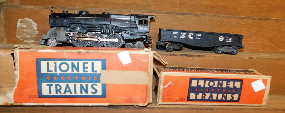 Lot 178: Lionel 2035 engine with car 2452x in original boxes- box condition is rough.