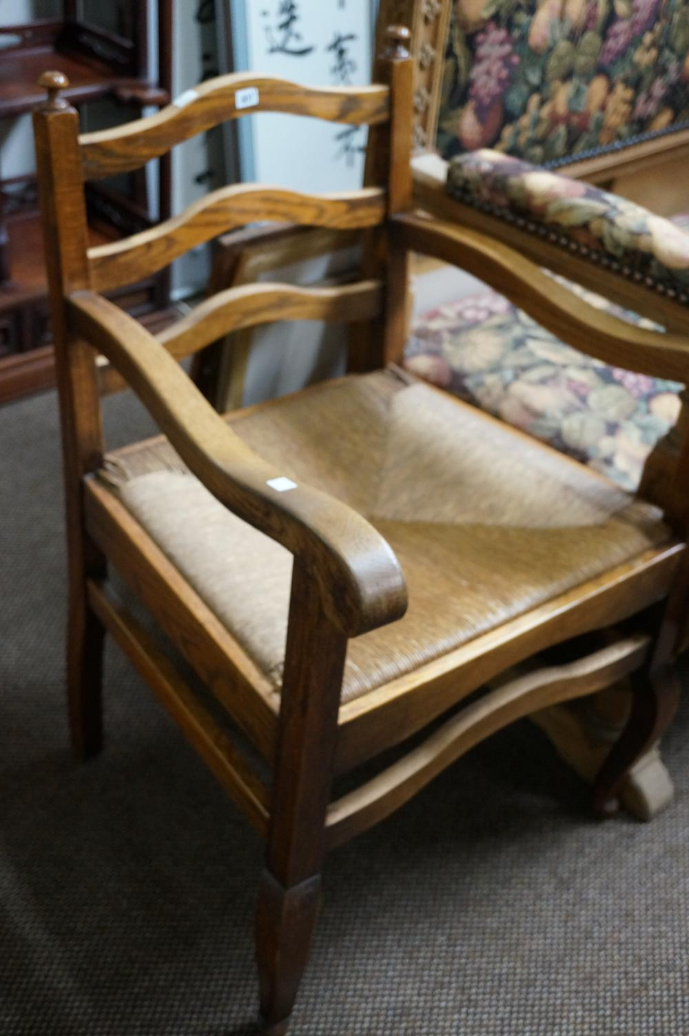 Antique French oak rush seat & ladder back arm chair