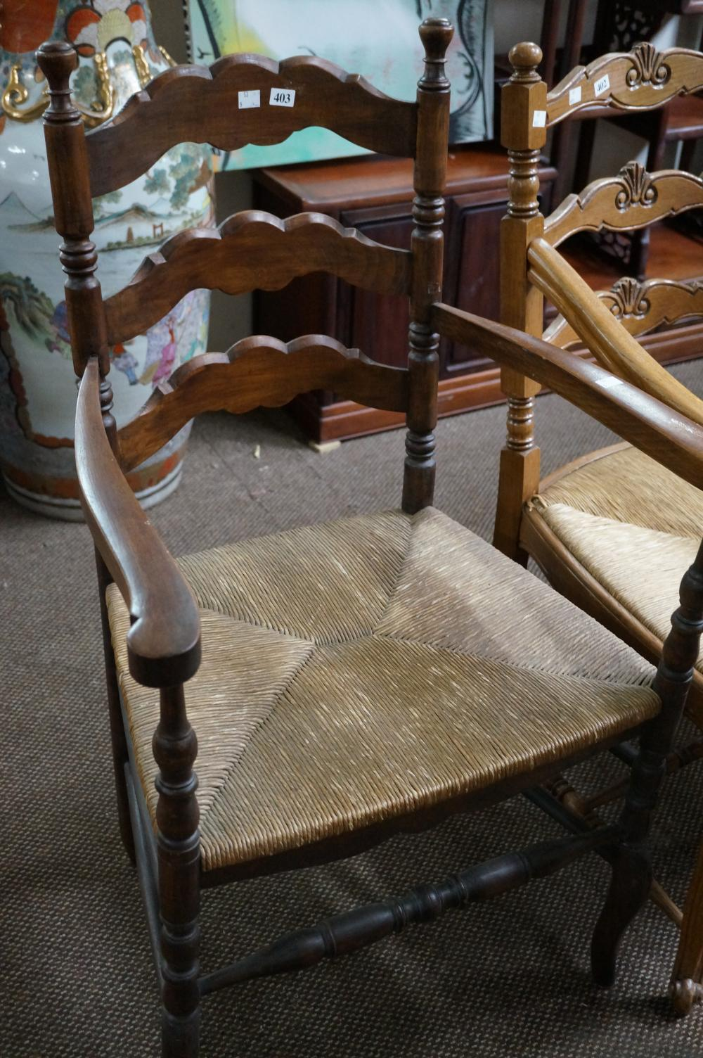 Antique French oak ladder back & rush seated arm chair