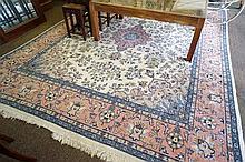 large cream woollen floor rug