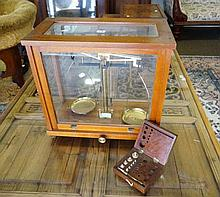 Cased set of apothacary scales with boxed set of