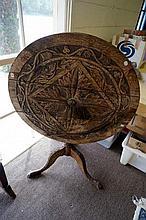 Georgian oak tilt top table, carved later in