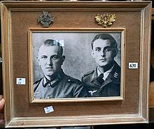 WWII framed photo of 2 German soldiers & 2 badges attched