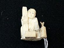 Japanese Meiji period ivory netsuke of man with tools