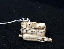 Antique Japanese carved ivory netsuke of basket with maze, signed on base
