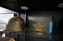 Mid C20th US Army tin helmet & 50 cal ammo box