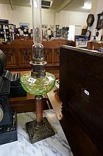 Antique uranium green glass kero lamp on alabaster column base
