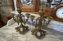 Pr C19th gilt metal garniture candelsticks with porcelain cupid panels