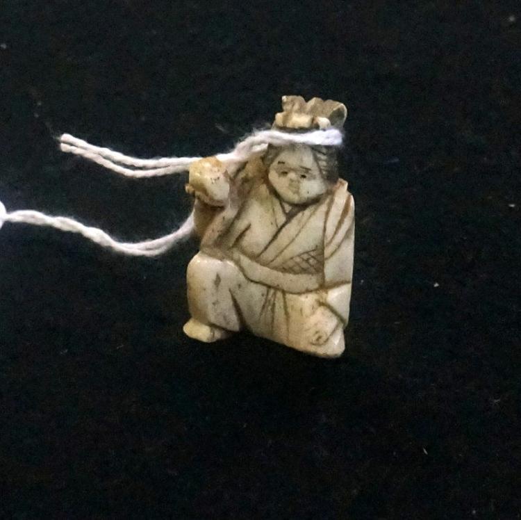 Antique Japanese Carved Bone Netsuke Of Seated Woman