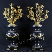 PAIR OF EARLY 19TH C. BLACK MARBLE AND GILT BRONZE