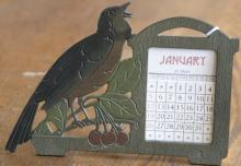 antique painted cast metal perpetual calendar with Red Robin bird and cherries
