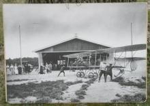 huge black and white photograph airplane hangar
