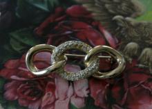 estate jewelry: designer pin brooch