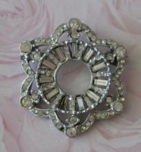 estate jewelry: floral shaped rhinestone pin brooch