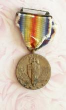 antique WWI victory military medal with silk and brass ribbon