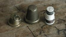 antique sewing spool in thimble