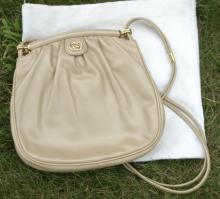 vintage beige leather Gucci bag with cloth cover