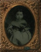 antique photograph in case of young girl or child