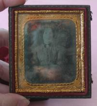 antique photograph in case of young woman or lady